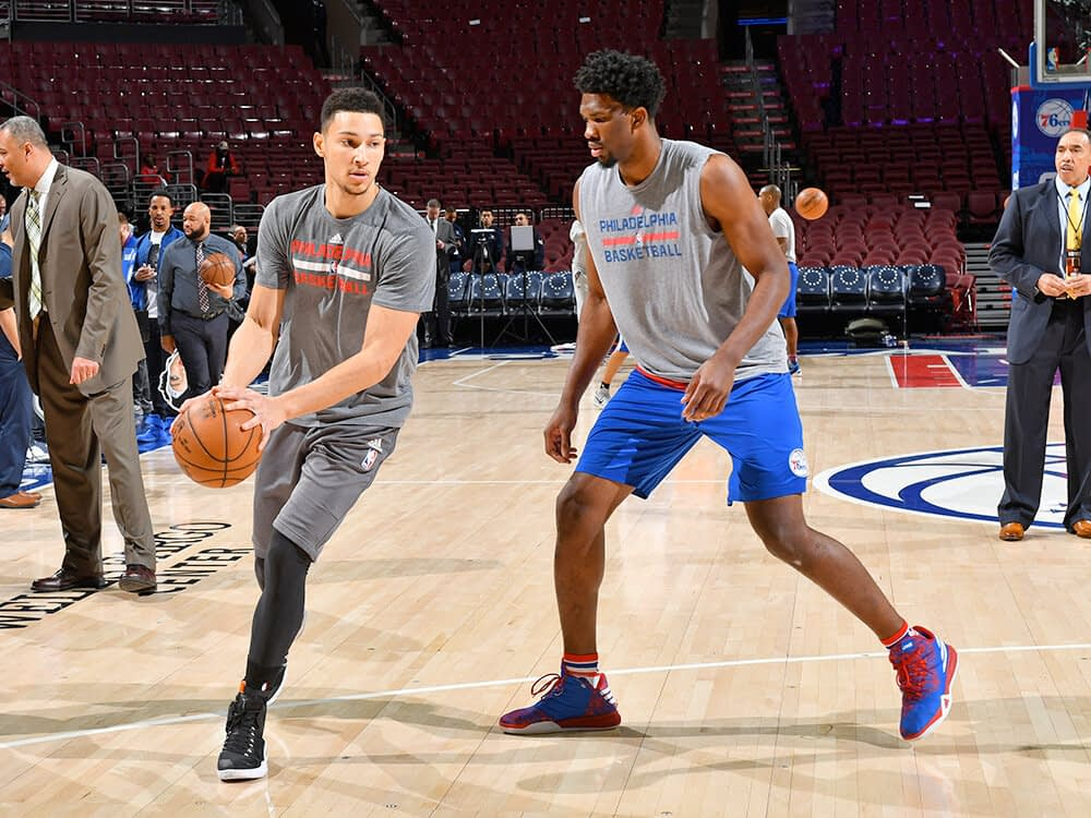 Sixers' Ben Simmons warms up with Joel Embiid